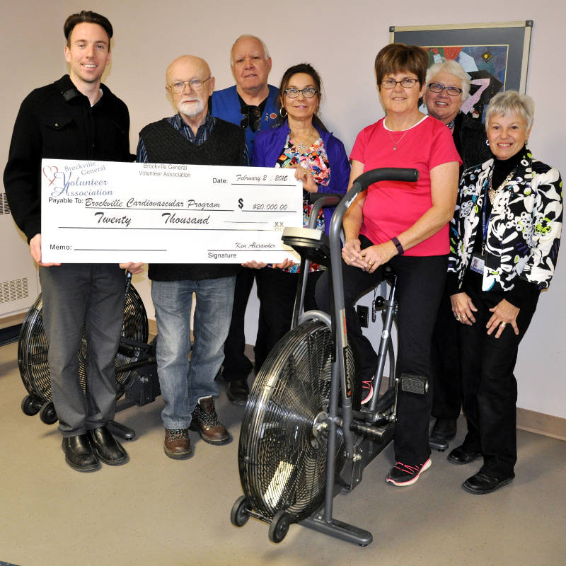 In this photo provided by the Brockville General Hospital, Jason Lafave, BCP Kinesiologist; Ken Alexander, Treasurer, BGVA; Dave Bessant, President, BGVA; Helen Ostap, Registered Nurse; Doreen Strader, patient; Karen Matte, VP BGVA and Linda Dickson, BGVA receive a cheque for the heart rehabilitation program at BGH. (Brockville General Hospital via Newswatch Group)