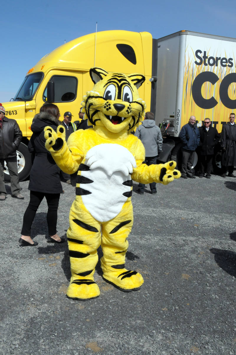Mascot Friendly the Tiger gives a wave Monday, April 4, 2016 during the groundbreaking for the company's future distribution center in Johnstown, Ont. The facility should be open in 2018. (Newswatch Group/Bill Kingston)