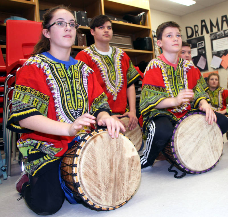 In this Thursday, April 14, 2016 photo supplied by the Upper Canada District School Board, students at North Grenville District High School play on some of the ten Djembe African drums bought with a $10,000 grant. (UCDSB via Newswatch Group)