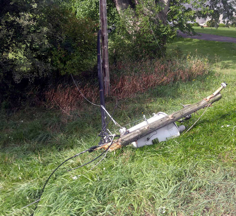 In this Sunday, Sept. 11, 2016 photo provided by Vanessa Sampson, a transformer is snapped off a hydro pole along Lyn Road. A series of intense thunderstorms raked the area Saturday night causing widespread damage. (Vanessa Sampson via Newswatch Group)