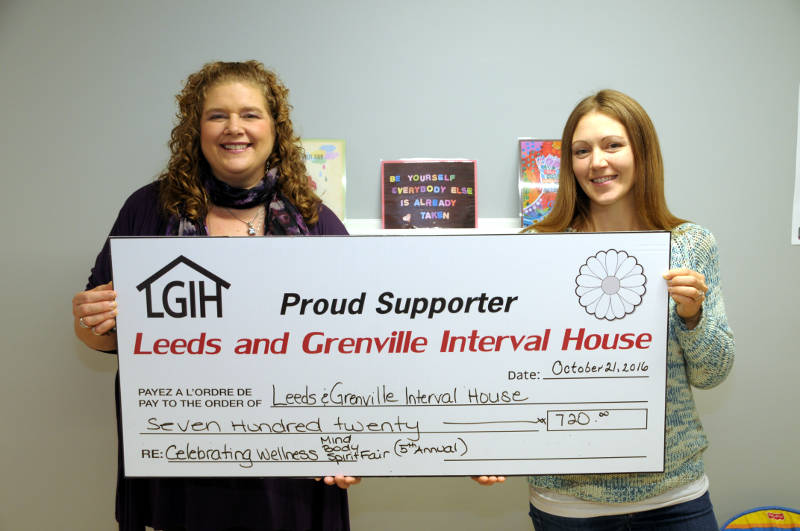 The Leeds and Grenville Interval House receives a $720.95 cheque on Friday, Oct. 21, 2016 from the fifth annual A Mind, Body and Spirit Fair. Interval House Community Development Coordinator Kimberley Wright, left, receives the donation from New Leaf Wellness owner Stephanie Forgues. (Newswatch Group/Bill Kingston)