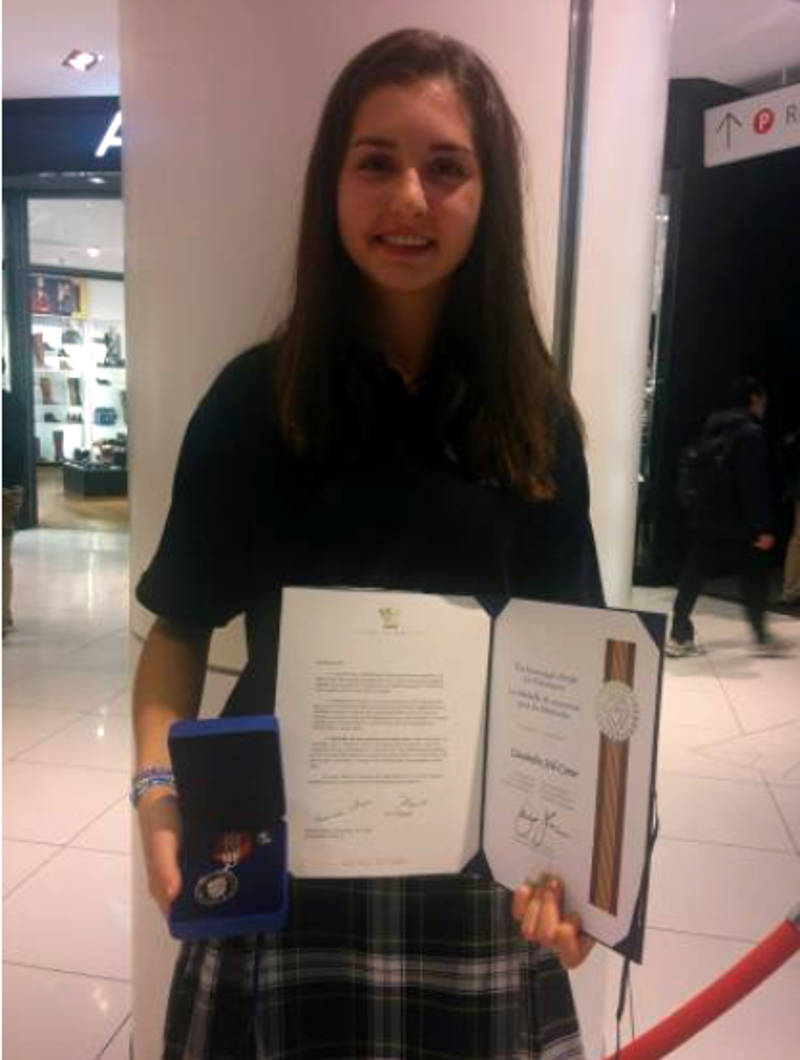 In this Thursday, Nov. 10, 2016 photo provided by the French Carholic school board, Cassandra 'Cassie' Joli-Coeur shows off her award from Governor General David Johnston. Cassie was singled out for her volunteerism. (CECCE via Newswatch Group)