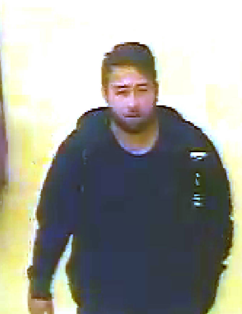 In this CCTV image provided by Brockville police, investigators want to speak to this man in connection to a stalking case over the weekend at a city grocery store. At this point, the man is considered a person of interest. (Brockville Police Service via Newswatch Group)