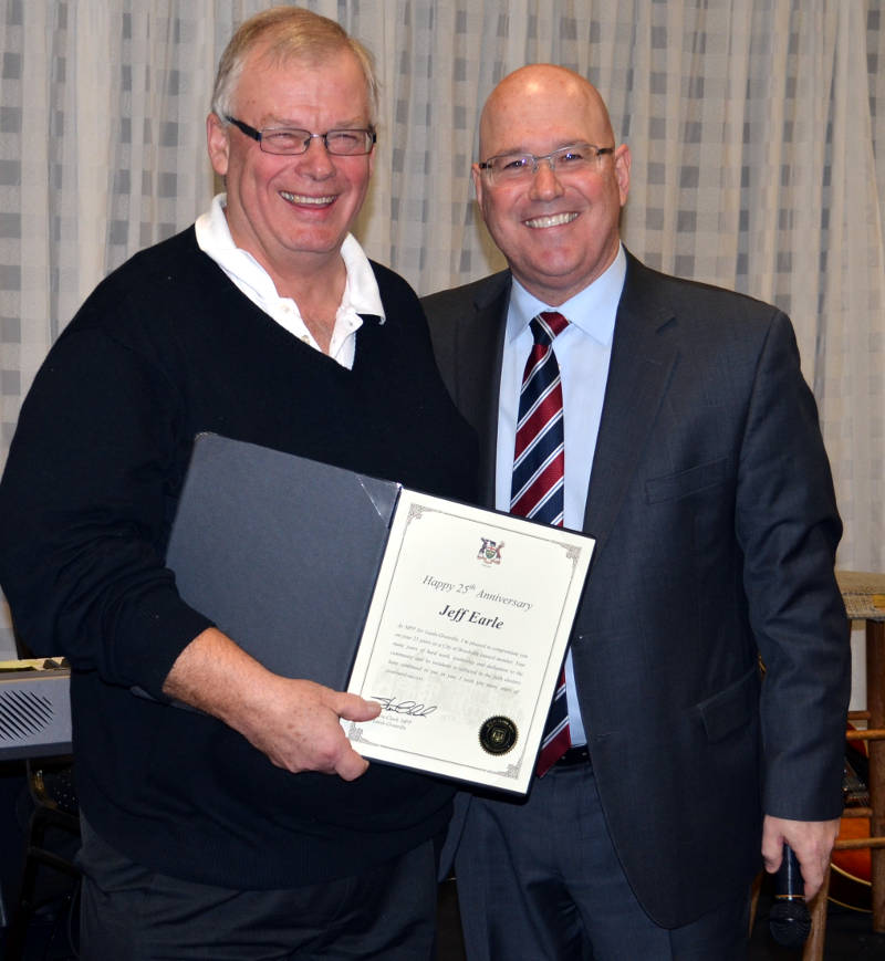 In this Sunday, Dec. 4, 2016 photo provided by MPP Steve Clark's office, Clark recognizes Brockville councillor Jeff Earle for 25 years of political service with the City of Brockville. (MPP Steve Clark via Newswatch Group)