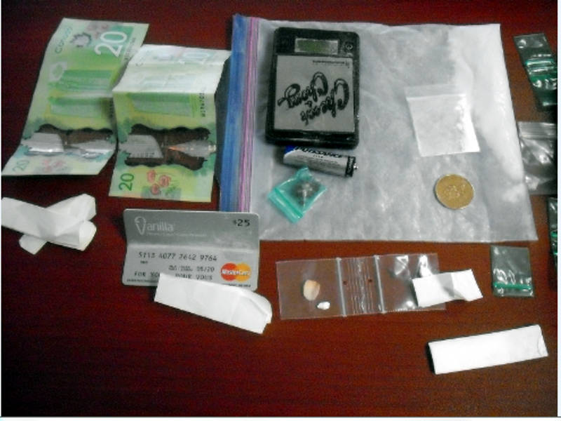 In this Thursday, Dec. 29, 2016 photo provided by Brockville police, drugs are laid out on a table as part of evidence in a seizure from a vehicle on Christmas Day. A Brockville officer is credited with his investigative skills in uncovering the $7,500 seizure. (Brockville Police Service via Newswatch Group)